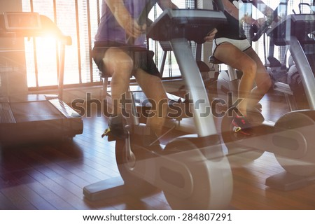Healthy couple training on a treadmill in a sport centre - stock photo