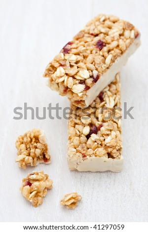 Healthy cranberry snack bar with white chocolate - stock photo