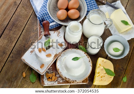 Healthy dairy products on rustic wooden background. Top view - stock photo