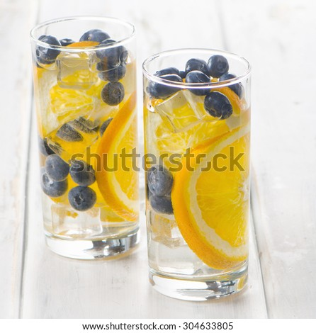 Healthy detox water with orange and blueberries  - stock photo