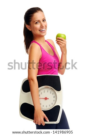 healthy diet eating woman with scale and apple for weightloss - stock photo