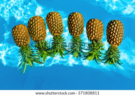 Healthy Diet Food. Fresh Raw Organic Ripe Pineapples Floating In Pure Water In Swimming Pool. Juicy Fruits. Nutrition And Lifestyle. Eating Vitamins For Beauty And Health. Go Vegan, Hydration Concept - stock photo