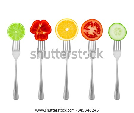 Healthy diet, organic food on forks with vegetables and fruit. Diet concept nutrition