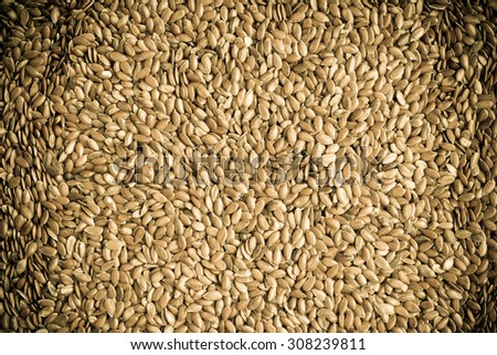 Healthy diet organic nutrition. Brown raw flax seeds linseed as natural food background - stock photo