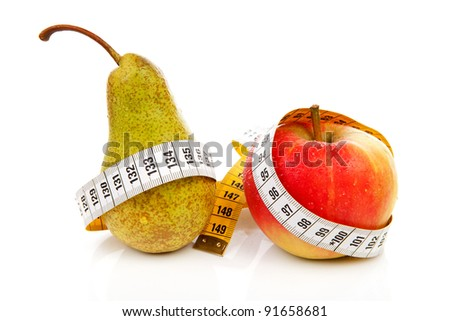 healthy diet; pear and apple with measure tape over white background - stock photo