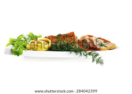 healthy dinner: grilled sea tuna fish with lemon and vegetables on white china plate isolated over white background - stock photo