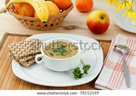 Healthy dinner with vegetable mashed soup and fruits.