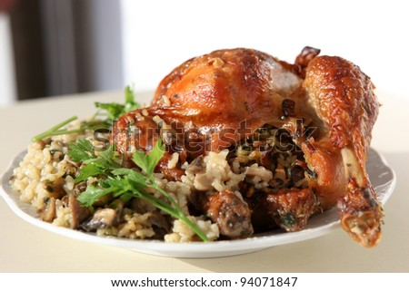 Healthy dish of mixed rice, chicken meat and vegetables - stock photo