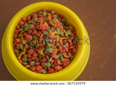 Healthy dog food in bowl on wood background with copy space. - stock photo