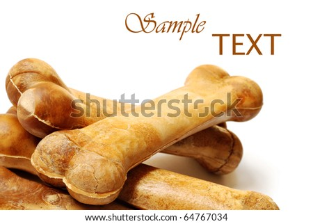 Healthy dog treats on white background with copy space.  Macro with shallow dof. - stock photo