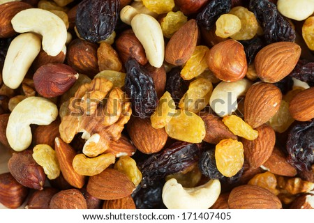 Healthy dried fruits and nuts closeup - stock photo