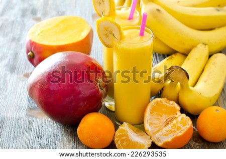 Healthy drink with fruits on wooden background