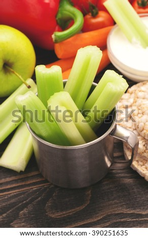 Healthy eating background. Close-up of various vegetables with fruits on a dark wooden table