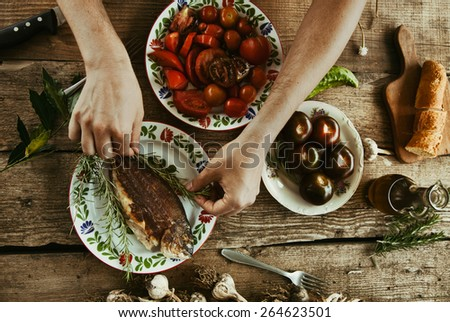 Healthy eating. Bream fish preparation. Seafood with vegetables - stock photo