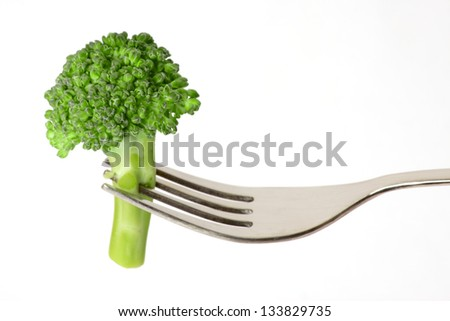 Healthy Eating Broccoli on Fork isolated on white background