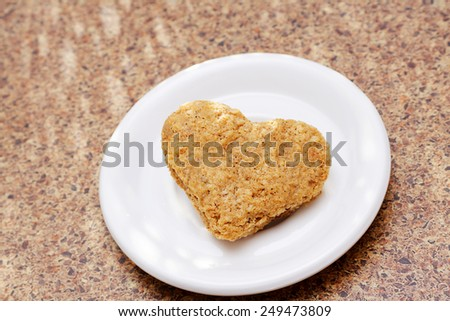Healthy eating concept, oatmeal cookie in the shape of a heart - stock photo