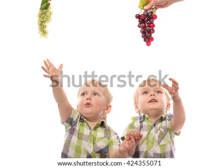 Healthy eating concept with childs takes grapes isolated on white - stock photo