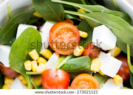healthy eating, dieting, vegetarian kitchen and cooking concept - close up of vegetable salad bowl at home - stock photo