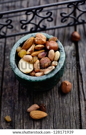 Healthy eating. Dried  fruit and nuts on wooden background - stock photo