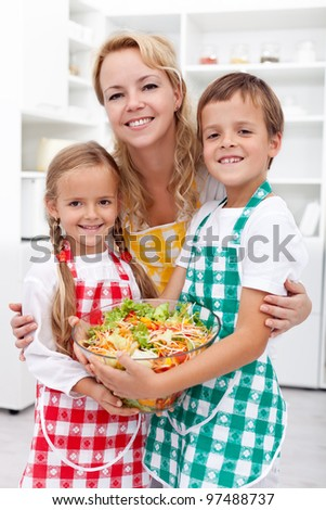 Healthy eating education concept - preparing a fresh salad with the kids
