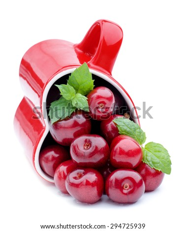 Healthy eating. Fresh sweet cherry and mint leaves. - stock photo