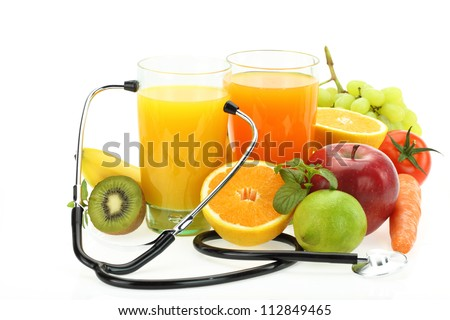 Healthy eating. Fruits, vegetables, juice and stethoscope - stock photo