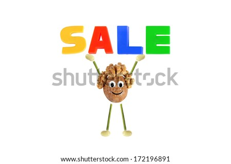 Healthy eating. Funny little man of the walnut lifting word - sale