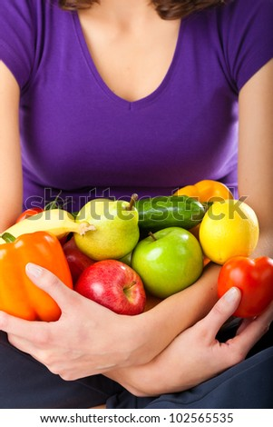 Healthy eating, happy woman with fruits and vegetables, closed-up - stock photo