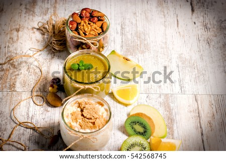 Healthy eating, healthy food - oat meal, green smoothie and nuts