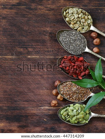 healthy eating ingredients super food - chia and flax seeds, goji berries, nuts - stock photo