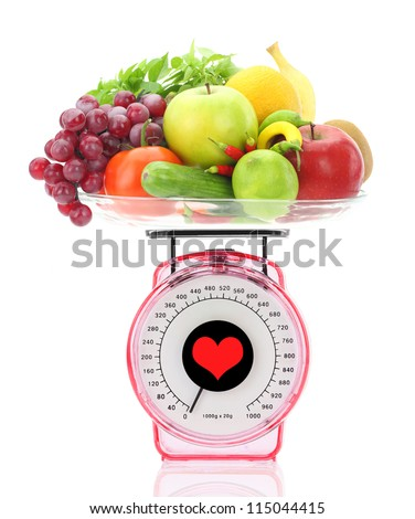 Healthy eating. Kitchen scale with fruits and vegetables