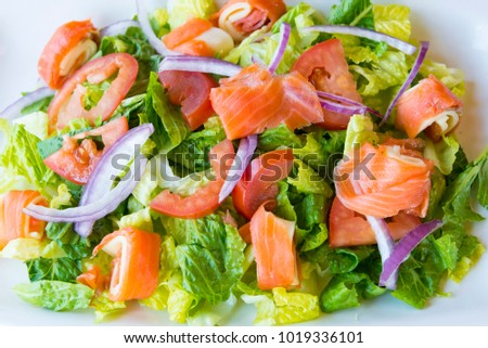 Healthy Eating: Large Salmon Green Salad. First World restaurants are changing more and more the menus to offer healthy choices to customers.