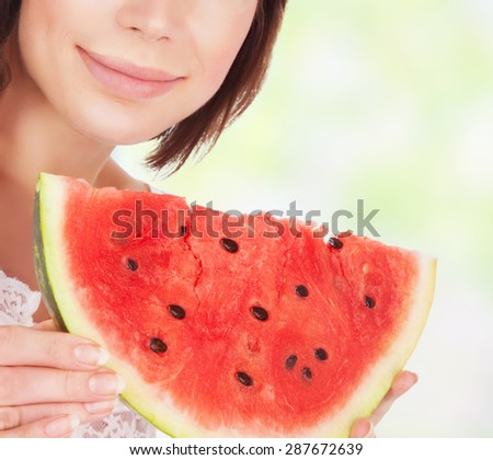 Healthy eating lifestyle, beautiful woman eating watermelon outdoors, face part, enjoying fresh red ripe fruit, sweet tasty juicy summertime dessert