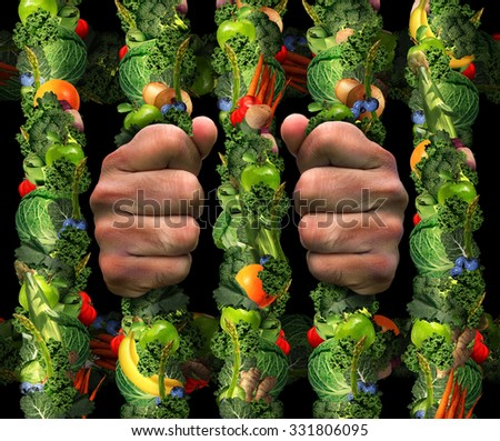 Healthy eating obsession  concept and addicted to health food symbol or or orthorexia nervosa as an extreme eating habit of consuming only certain healthy pure foods as hands holding prison bars. - stock photo