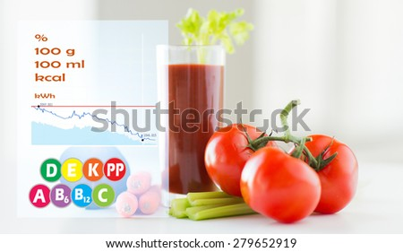 healthy eating, organic food and diet concept - close up of fresh tomato juice glass and vegetables on table with calories and vitamin chart - stock photo