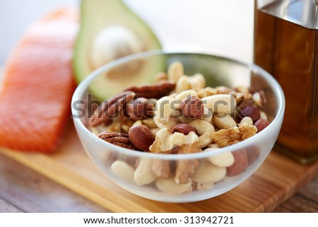 healthy eating, protein food, diet and culinary concept - close up of nut mix in glass bowl on table - stock photo
