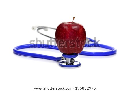 Healthy eating . red apple on stethoscope isolated on white - stock photo
