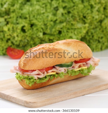 Healthy eating sub deli sandwich baguette with ham, cheese, tomatoes and lettuce - stock photo