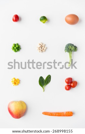 healthy eating, vegetarian food, diet and culinary concept - close up of ripe vegetables and food over white - stock photo