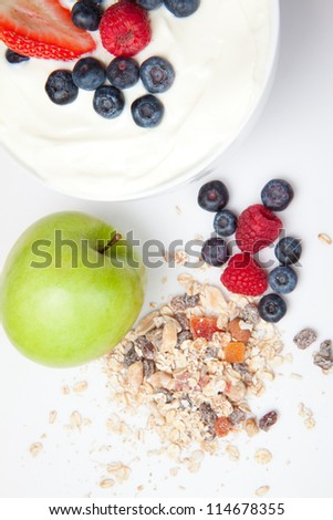 Healthy eating with fruits and cereals  against a white background
