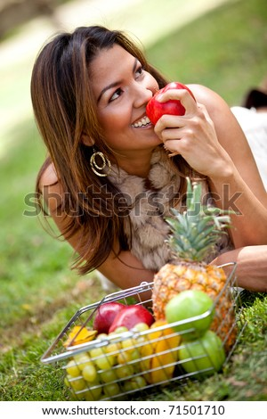 Healthy eating woman with a basket of fruits ? outdoors - stock photo