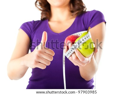 Healthy eating - woman with apple and pear and measuring tape dieting - stock photo
