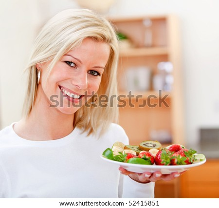 Healthy eating woman with fruits and smiling - stock photo