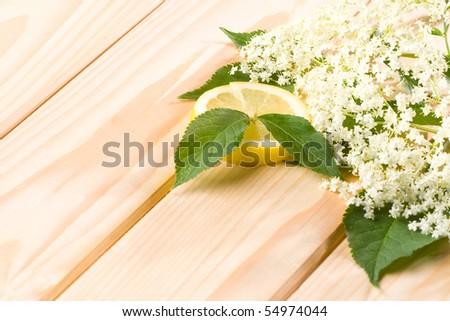 Healthy elder flower with lemon on wooden background. - stock photo