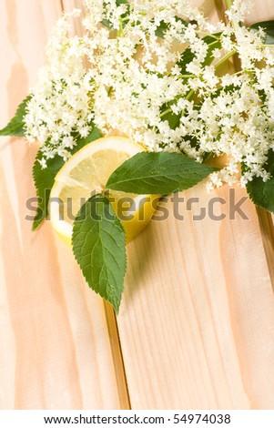 Healthy elder flowerwith lemon on wooden background. - stock photo