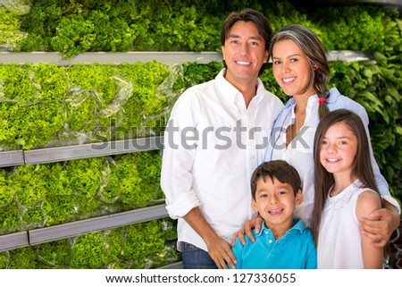 Healthy family buying groceries like fresh vegetables - stock photo