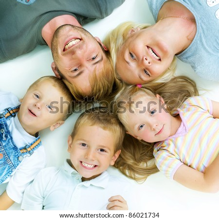 Healthy Family. Parents with three kids having fun together - stock photo
