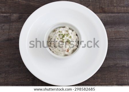 Healthy fat free Greek yogurt dip with caramelised onion and fresh herb thyme. - stock photo
