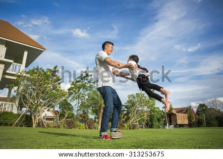 Healthy father and daughter playing together at the Home carefree happy fun smiling lifestyle, family concept - stock photo