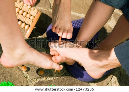 Healthy feet series: feet of men and women of different ages performing feet gymnastics with various tools and toys